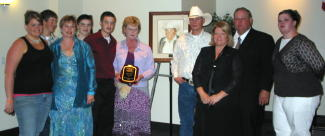 The family of the late Warren Bessman, Madison, accepts the 2006 Hall of Fame plaque for