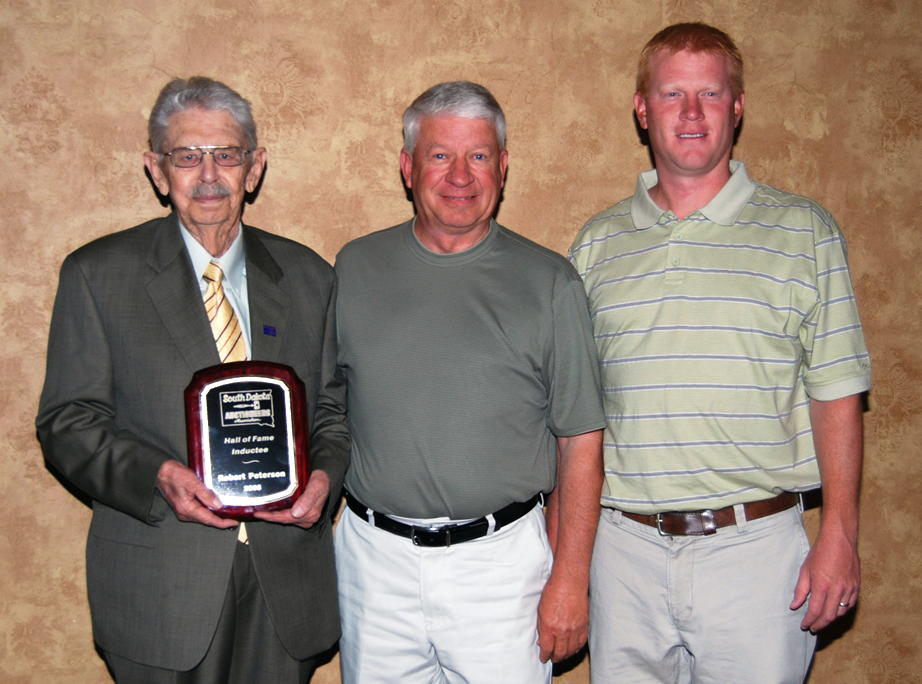 From left to right: Robert Peterson, Brookings, was inducted into the