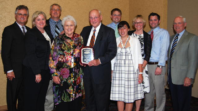 The family of John Owen, Watertown, was on hand to celebrate John's induction into the South Dakota Auctioneers Hall of Fame. Holding the plaque is John with his wife, Beverly at left.