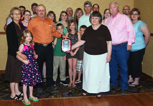 The family of the late Gilbert Wagner, Reliance, accepted the plaque to honor Gilbert's induction into the South Dakota Auctioneers Hall of Fame. Gilbert's children, Mark and Kathleen are shown holding the plaque.