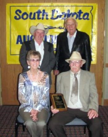 Accepting the Hall of Fame award in Memory of Sam Eslinger is his brother Jack (Sharon) Eslinger New Castle Wy.