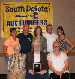 New inductee to the SDAA Hall of Fame Richard Penrod Gettysburg SD (Center) and wife Joy (Right) and Family